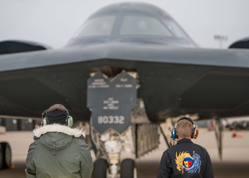 Two crew chiefs, assigned to the 509th Maintenance Group, Whiteman Air Force  Base, Missouri, prepare to recover a B-2 Spirit Stealth Bomber on Oct 24, 2019. Routine training prepares Airmen to execute the global strike missions anytime, anywhere. (U.S. Air Force photo by Senior Airman Thomas Barley)