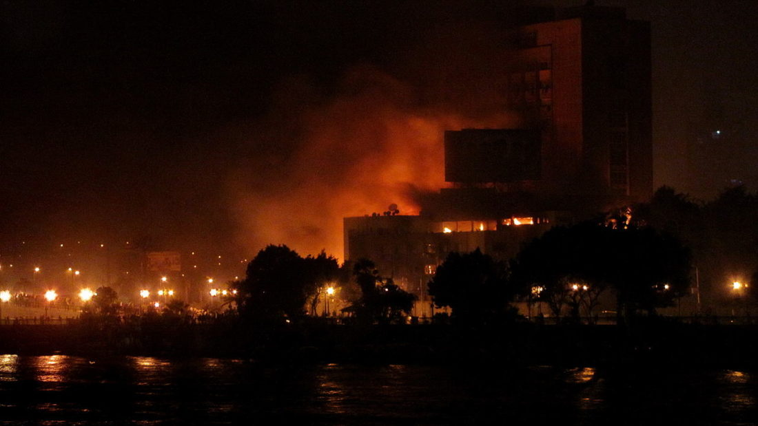 The main headquarters of the National Democratic Party after being set on fire during the 2011 Egyptian protests.Author_Sherif9282